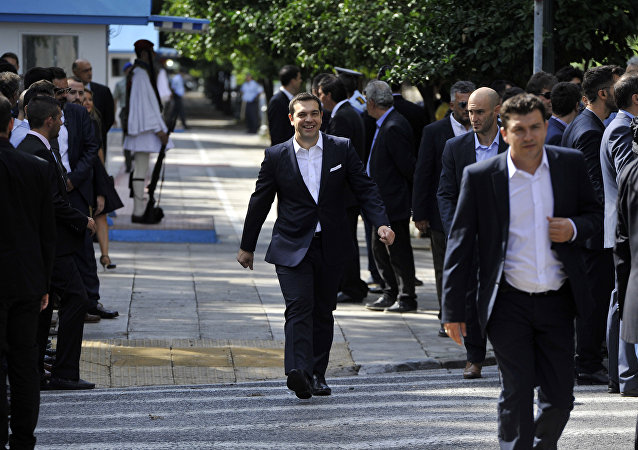 Greece's Prime Minister Alexis Tsipras leaves the presidential palace after his cabinet's swearing in ceremony in Athens, Wednesday, Sept. 23, 2015