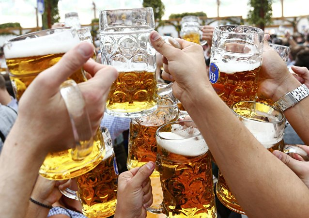 Visitors toast with beer on the first day of the 182nd Oktoberfest in Munich, Germany, September 19, 2015