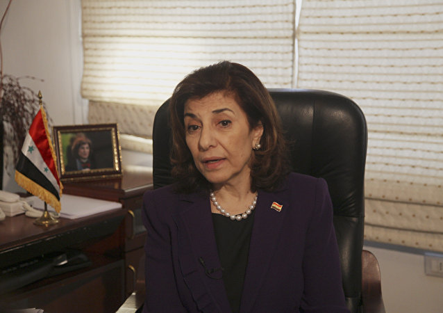 Bouthaina Shaaban, Syrian President Bashar Assad's political adviser, speaks during an interview with The Associated Press