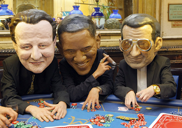 Oxfam international activists pose as British Prime Minister, David Cameron, left, United State President Barak Obama, and French President Nicolas Sarkozy, right.