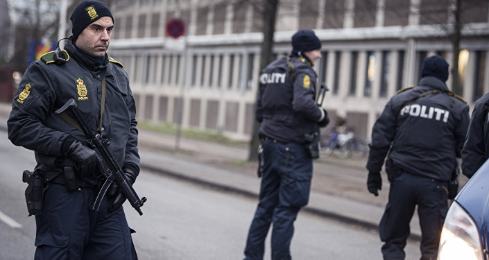 Police officers guard the street around the Noerrebro train station in Copenhagen on February 15, 2015 after a man has been shot in a police action following two fatal attacks in the Danish capital.