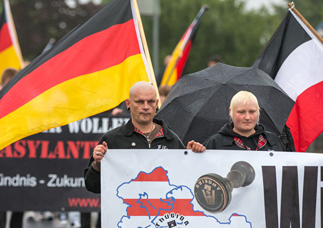 German right-wing supporters of Thuegida, the local group of the PEGIDA movement Patriotic Europeans Against the Islamification of the Occident take part in a march in Suhl, eastern Germany on August 17, 2015.