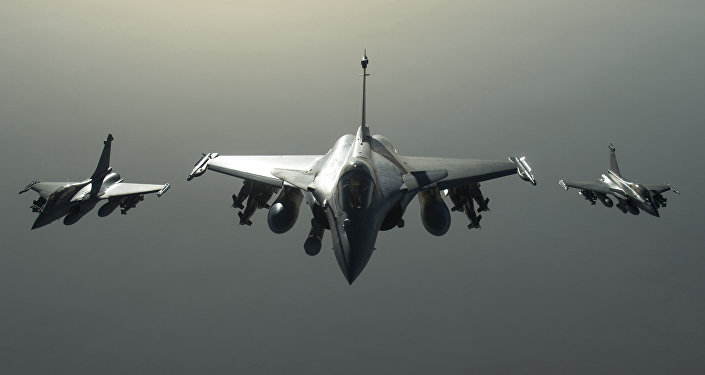 This photo released on Sunday, Sept. 27, 2015 by the French Army Communications Audiovisual office (ECPAD) shows French army Rafale fighter jets flying towards Syria as part of France's Operation Chammal launched in September 2015 in support of the US-led coalition against Islamic State group