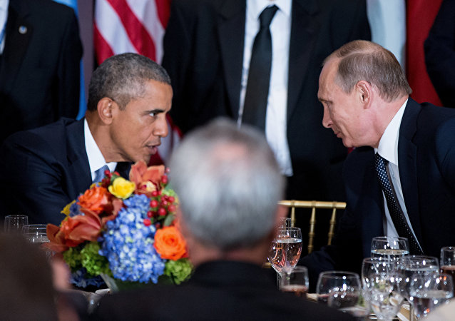 President Barack Obama and Russian President President Vladimir Putin greet each other during a luncheon, Monday, Sept. 28, 2015, at United Nations headquarters.