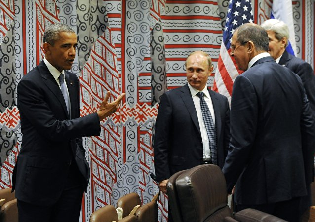 US President Barack Obama, left, gestures while speaking to Russian President Vladimir Putin, third right, as Russian Foreign Minister Sergey Lavrov, second right, and US Secretary of State John Kerry, right, look at him before a bilateral meeting at United Nations headquarters in New York, Monday, Sept. 28, 2015.