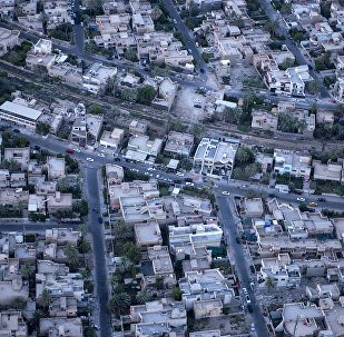 An aerial picture taken on board a helicopter shows a view of the Iraqi capital Baghdad on June 23, 2014