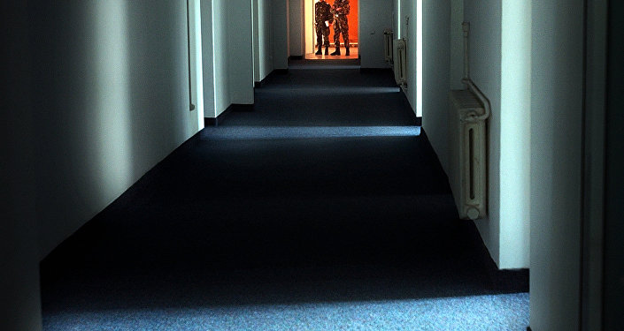 In this Wednesday, Nov. 9, 2005, file picture Romanian military staff stand at the end of a corridor on the Mihail Kogalniceanu airbase, near the Black Sea port of Constanta, a Soviet-era facility which became a key focus of a European investigation into allegations that the CIA operated secret prisons, some 250 kilometers (155 miles) east of Bucharest, Romania.