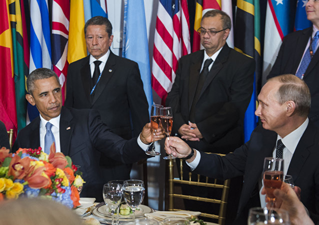 In this Monday, Sept. 28, 2015, photo, provided by the United Nations, US President Barack Obama, left, and Russia's President Vladimir Putin toast during a luncheon hosted during the 70th annual United Nations General Assembly at U.N. headquarters