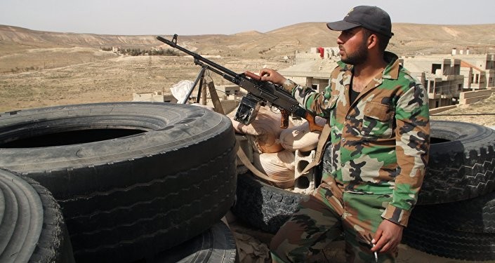 Syrian army soldiers at a checkpoint in the Syrian town of Maaloula, 55 km from Damascus, which was twice captured and looted by Jabhat al-Nusra militants
