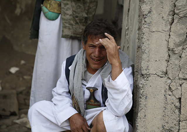 A man cries after some of his relatives were killed in a Saudi-led airstrike in Sanaa, Yemen, Monday, Sept. 21, 2015.