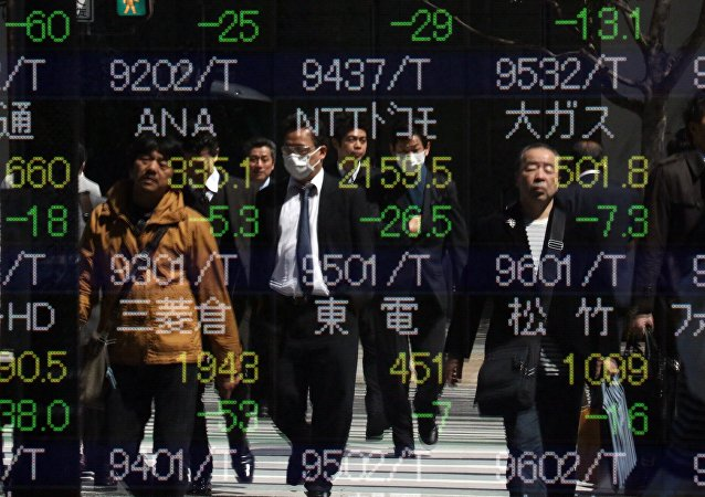 Pedestrians are reflected in the window of a securities company shows the numbers of the Tokyo Stock Exchange in Tokyo on March 26, 2015