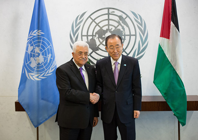 The State of Palestine's President Mahmoud Abbas, left, poses with United Nations Secretary-General Ban Ki-moon at the United Nations headquarters Wednesday, Sept. 30, 2015