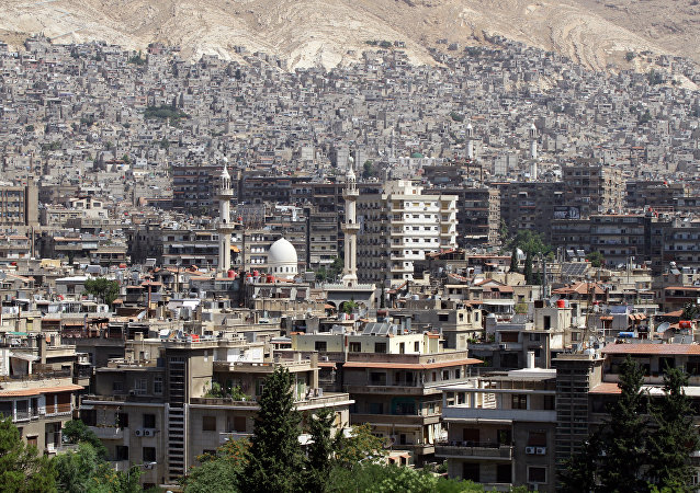 A general view shot taken on June 30, 2015, shows a neighbourhood in the Syrian capital Damascus