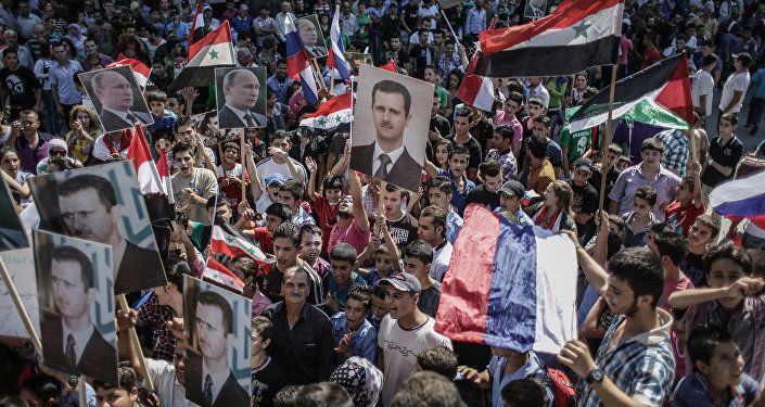 Rally to support Bashar al-Assad and Vladimir Putin in Latakia, file photo