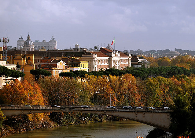 View of the Tiber river in Rome where tree leaves bear their Autumn colors