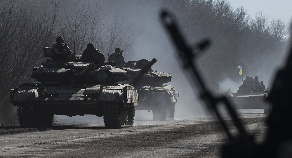 File photo of Ukrainian troops ride on tanks near Artemivsk, eastern Ukraine, Tuesday, Feb. 24, 2015