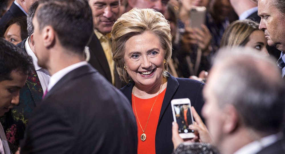 Democratic presidential candidate Hillary Clinton has a picture taken by a supporter after speaking at the Human Rights Campaign Breakfast in Washington, October 3, 2015