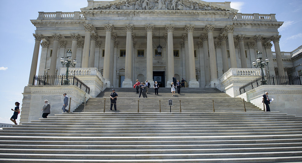 Members of Congress leave after a series of votes effecting the fast tracking of the Trans-Pacific Partnership on Capitol Hill June 12, 2015 in Washington, DC. The House of Representatives voted down a bill that will could effect the fast tracking of the Trans-Pacific Partnership trade agreement.