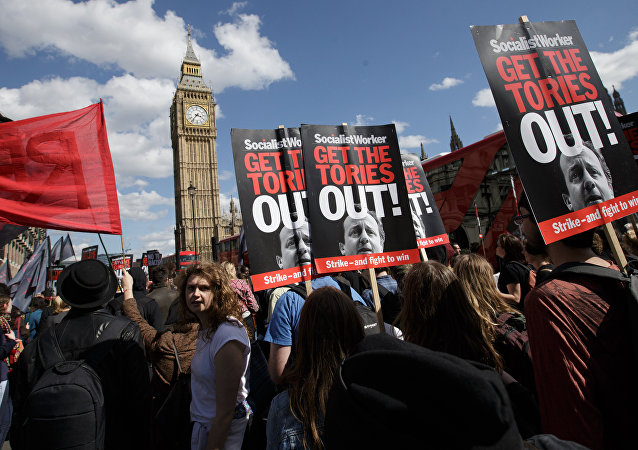 Protesters demonstrate against the Conservative government in Westminster, London, Saturday, May 9, 2015. David Cameron's Conservative Party swept to power Friday in Britain's Parliamentary General Elections, winning an unexpected majority.
