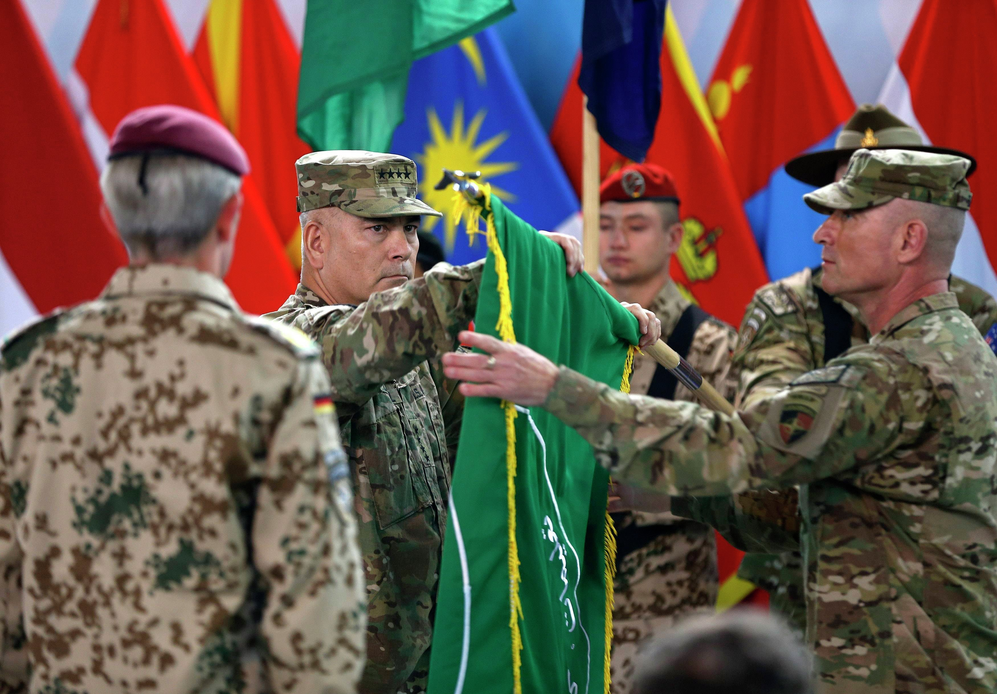US Army General John Campbell has said that the Islamic State is carrying out a recruitment drive in Afghanistan and Pakistan. Photo: Campbell, center, folds the flag of the International Security Assistance Force in a change of mission ceremony in Kabul, December 28, 2014.