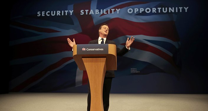 Britain's Prime Minister David Cameron gestures as he delivers his keynote address at the annual Conservative Party Conference in Manchester, Britain October 7, 2015