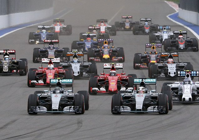 Mercedes Formula One driver Nico Rosberg of Germany and his team mate Lewis Hamilton of Britain (front L-R) lead during the start of the Russian F1 Grand Prix in Sochi, Russia, October 11, 2015
