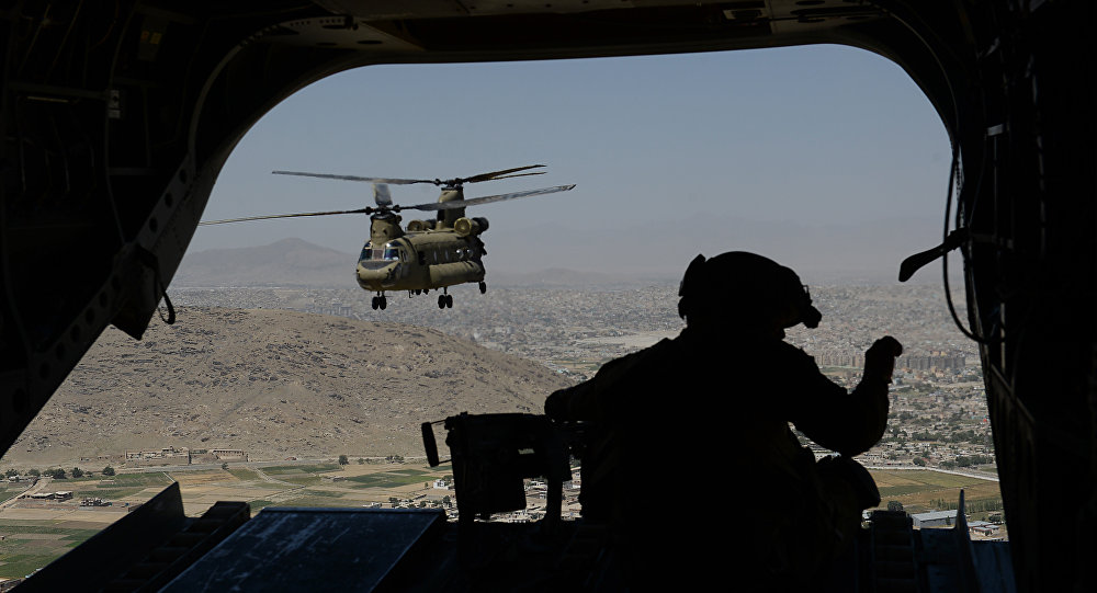 This photo taken on august 11, 2014 shows a US soldier, part of the NATO-led International Security Assistance Force (ISAF), manning a machine gun onboard a Chinook helicopter over the Gardez district of Paktia province