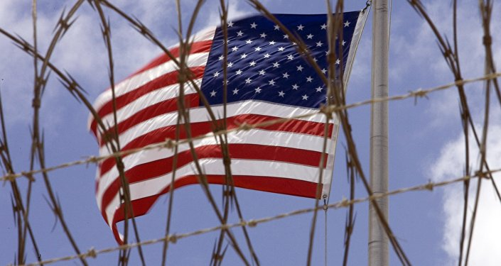 A US flag flies in this April 24 2007 file photo at Camp V inside Camp Delta at the US Naval Station in Guantanamo Bay, Cuba