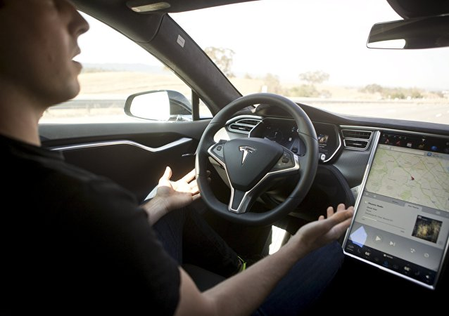 New Autopilot features are demonstrated in a Tesla Model S during a Tesla event in Palo Alto, California October 14, 2015