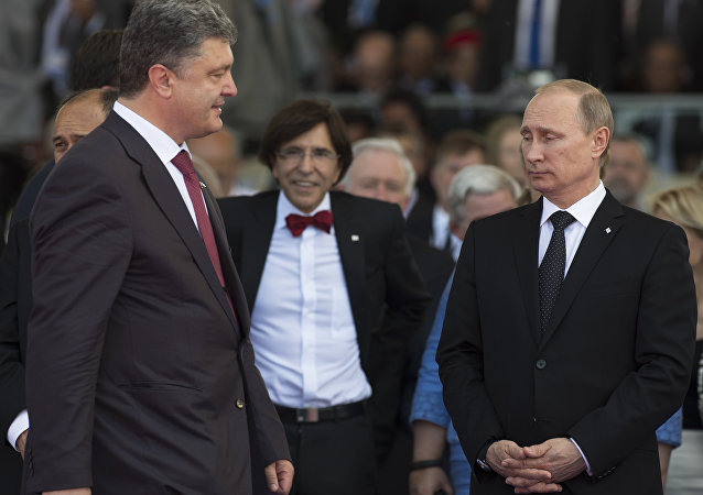 Ukraine's President-elect Petro Poroshenko (L) walks past Russia's President Vladimir Putin (R) during an international D-Day commemoration ceremony on the beach of Ouistreham, Normandy, on June 6, 2014