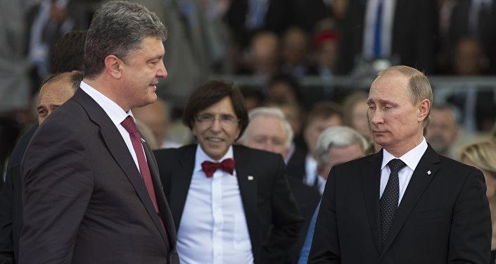 Ukraine's President-elect Petro Poroshenko (L) walks past Russia's President Vladimir Putin (R) during an international D-Day commemoration ceremony on the beach of Ouistreham, Normandy, on June 6, 2014