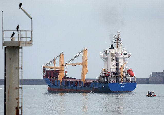The BBC Shanghai cargo ship leaves the habour on October 15, 2015 in Cherbourg-Octeville. The vessel, whose security has been questioned, delivers nuclear waste back to Australia after its reprocessing in France