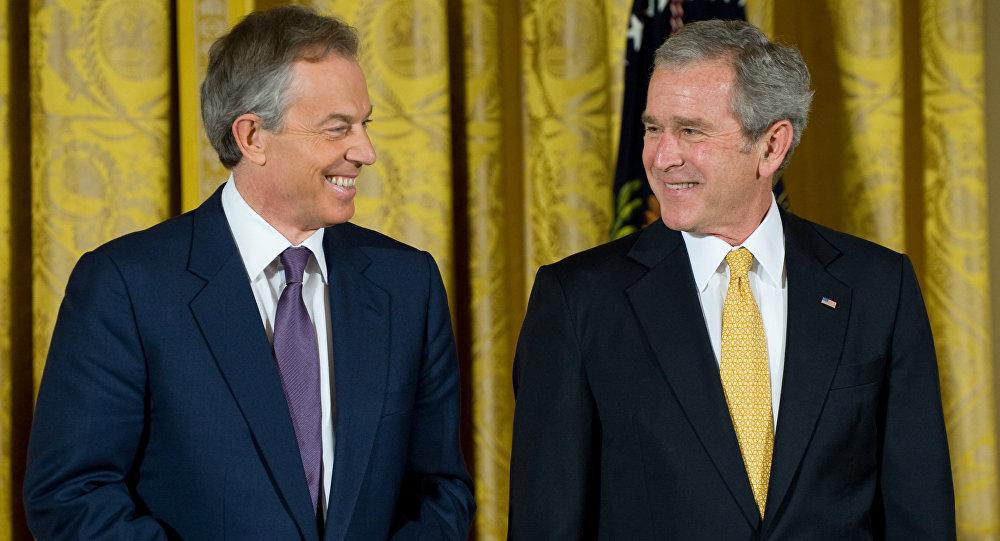 Former US President George W. Bush smiles alongside former British Prime Minister Tony Blair.