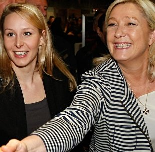 French far-right Front National leader Marine Le Pen, right, and her niece Front National Deputy Marion Marechal Le Pen, center.