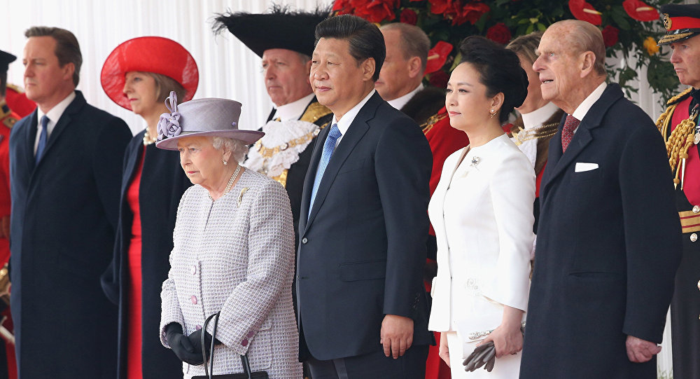 Britain's Queen Elizabeth II, foreground left, stands with Chinese President Xi Jinping, his wife, Peng Liyuan and Prince Philip, during the official ceremonial welcome for the Chinese State Visit, in London