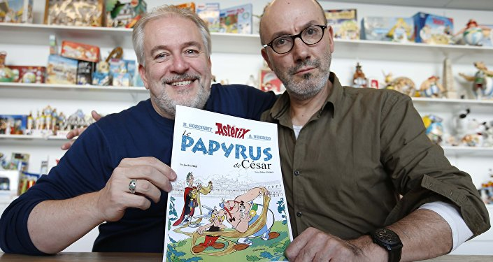 Author Jean-Yves Ferri (R) and illustrator Didier Conrad (L) pose with a print of the cover of their new comic book Le Papyrus de Cesar (Asterix and the Missing Scroll) in Vanves, Southern Paris, France, October 13, 2015