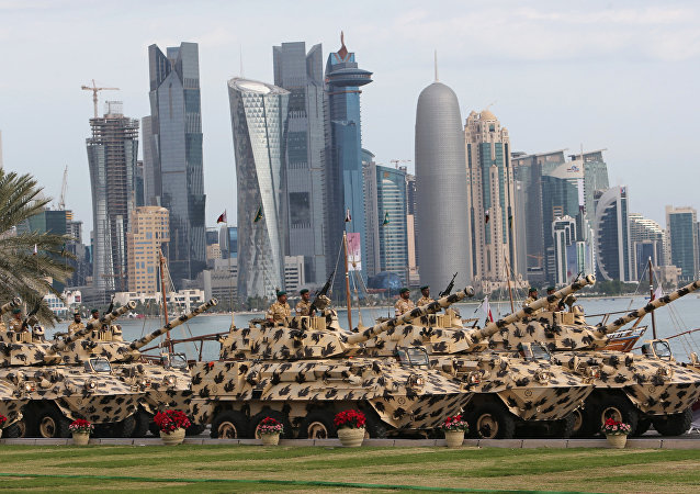 A general view show armoured vehicles rolling during the military parade marking the Gulf emirate's National Day celebrations in Doha on December 18, 2012