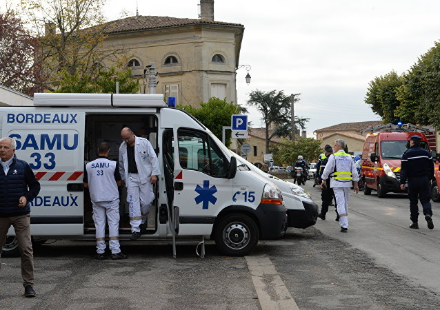 Rescuers are pictured on October 23, 2015 in Puisseguin, near Libourne, southwestern France, following a road accident in which at least 42 people, most of them elderly, were killed when a coach collided with a lorry and caught fire in southwest France, in the country's worst road accident for three decades, officials said