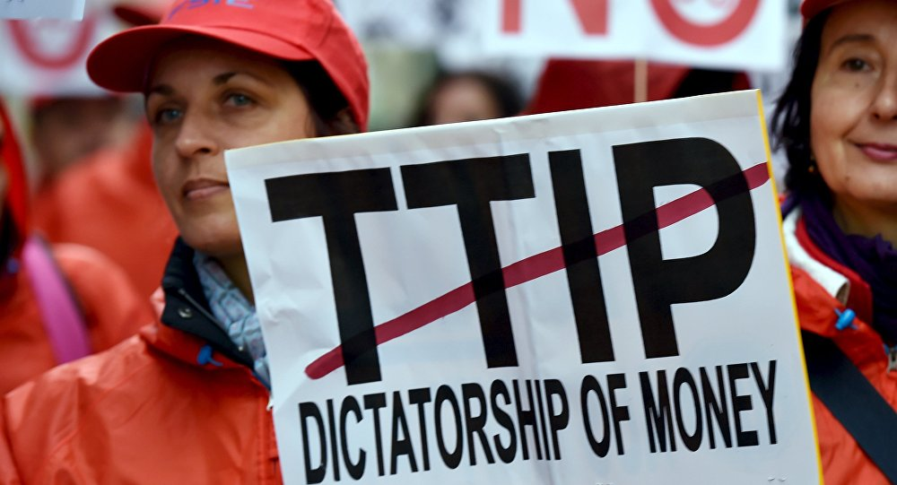 European consumer rights activists take part in a march to protest against the Transatlantic Trade and Investment Partnership (TTIP), austerity and poverty in Brussels, Belgium October 17, 2015