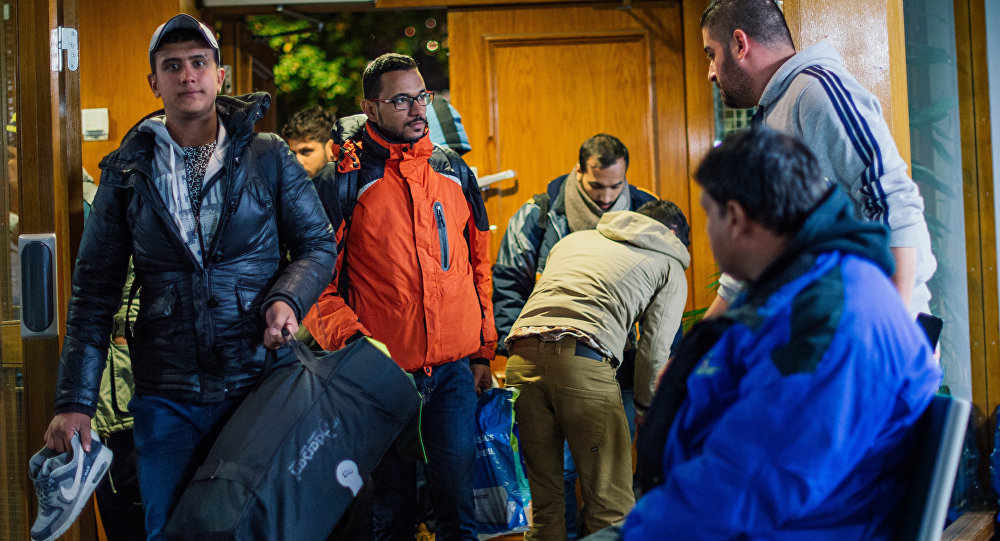 Refugee's arrive to Stockholm central mosque on October 15, 2015 after many hours bus journey from the southern city of Malmo