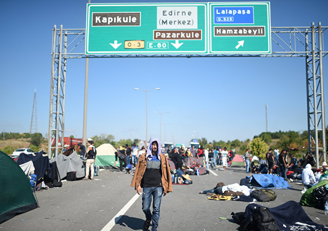 A man walks after Turkish police forces blocked migrants and refugees on a highway near Edirn during their march to the border between Turkey and Greece
