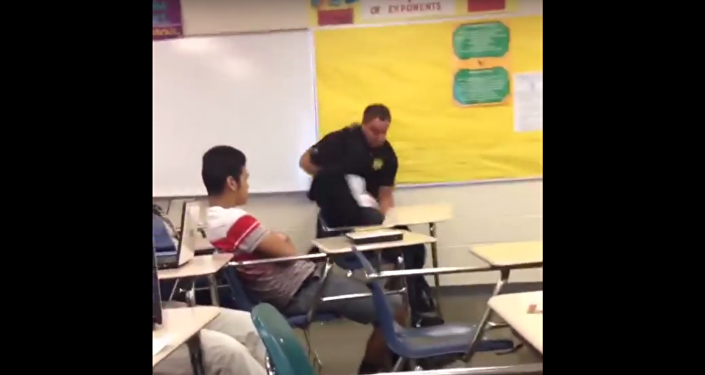 A cop fights a student at Spring Valley High School.