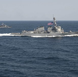 USS Lassen (DDG 82), (R) transits in formation with ROKS Sokcho (PCC 778) during exercise Foal Eagle 2015, in waters east of the Korean Peninsula