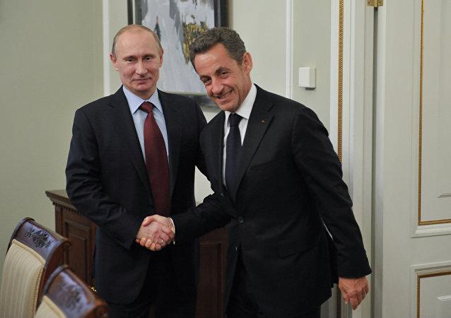 President Vladimir Putin, left, and former French President Nicolas Sarkozy meet in the Novo-Ogaryovo residence. (File)