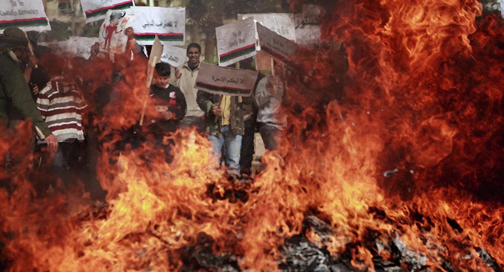Benghazi residents burn portraits of Muammar Gaddafi