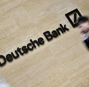 Workers walk past the London headquarters of Deutsche Bank in the City of London, Britain in this May 19, 2015 file photo