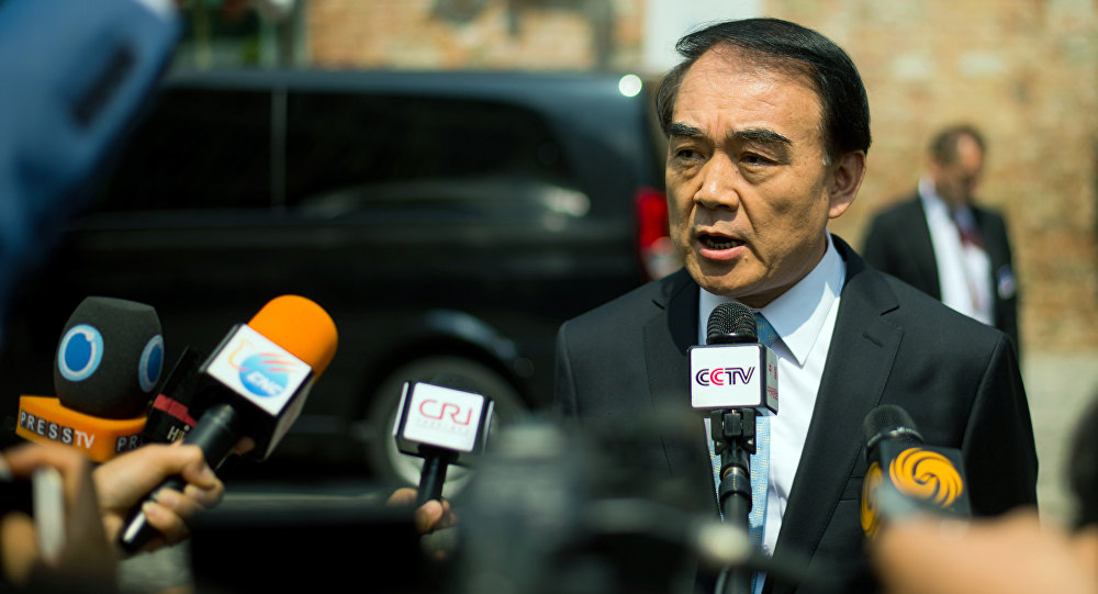 Chinese Deputy Foreign Minister Li Baodong addresses the media in front of the Palais Coburg Hotel, the venue of the nuclear talks in Vienna, Austria on June 28, 2015