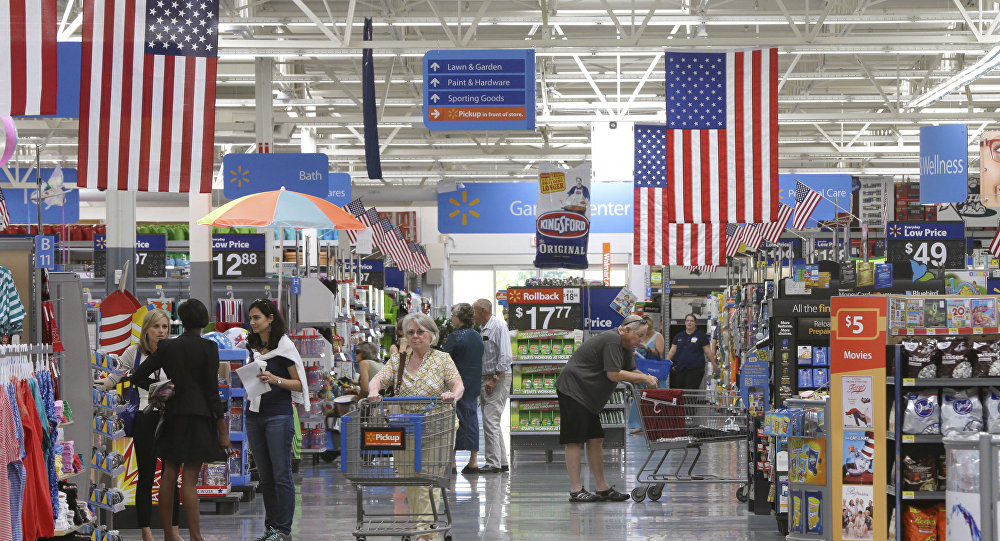 Customers shop on widened aisles at a Wal-Mart Supercenter store in Springdale, Ark., Thursday, June 4, 2015