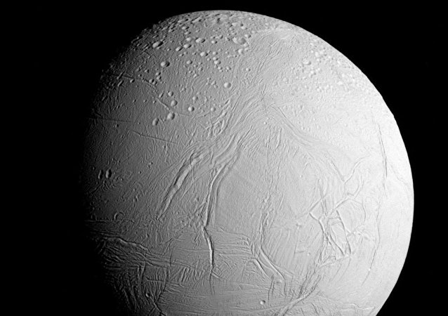 NASA's Cassini spacecraft captured this view as it neared icy Enceladus for its closest-ever dive past the moon's active south polar region