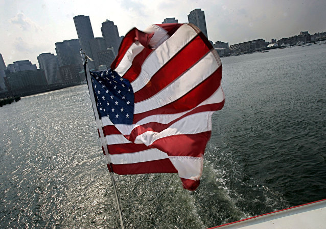 A United States flag flies on a ship of Massachusetts Bay Lines, Inc., against Boston skyline during Birth of A Nation Harbor Tours in Boston, Tuesday, July 11, 2006